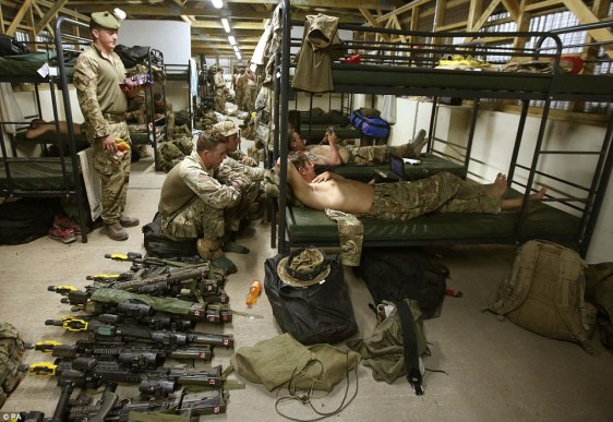 25B41A9500000578-2954729-Short_rest_Soldiers_from_C_company_watch_TV_as_they_sort_kit_in_-a-22_1424037902756
