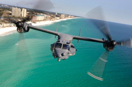 090131-F-9372L-530        A CV-22 Osprey aircraft from the 8th Special Operations Squadron flies over the Emerald Coast outside Hurlburt Field, Fla., on Jan. 31, 2009.  While over the water, the crew practiced using a hoist, which is used to rescue stranded personnel.  DoD photo by Senior Airman Julianne Showalter, U.S. Air Force.  (Released)