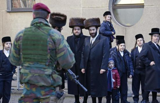 a-belgian-paratrooper-guards-outside-a-jewish-school-in-the-central-city-of-antwerp