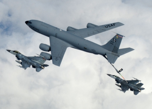 "A KC-135 Stratotanker from Royal Air Force Mildenhall, England, refuels a pair of F-16 Fighting Falcons April 7 during a multinational exercise over the Baltic States. The Stratotankers from RAF Mildenhall feature the ""Box D"" tail marking, dating back to World War II. (U.S. Air Force photo/Staff Sgt. Jerry Fleshman)"