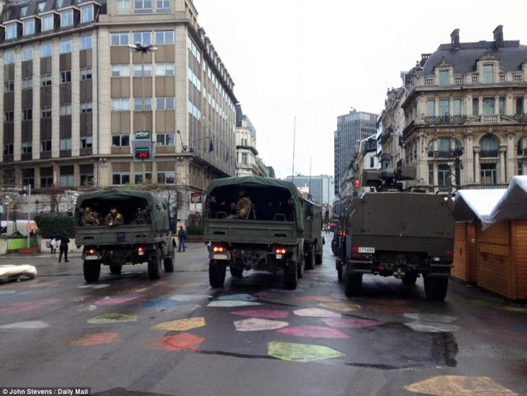2EA97C1C00000578-3328154-Trucks_filled_with_army_personnel_take_up_positions_inside_the_h-a-36_1448104551075