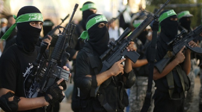 Hamas militants march during a rally in memory of people who were killed during a seven-week Israeli offensive, in Gaza City