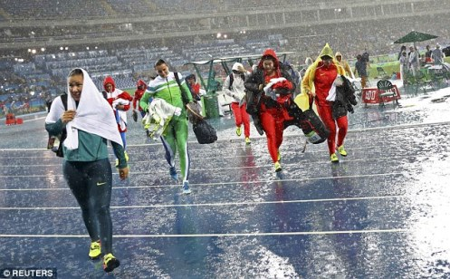 3745FC7C00000578-3742489-Competitors_leave_the_field_during_discus_competition_as_it_rain-a-88_1471309806103