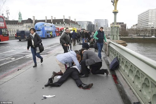 3E86F19300000578-4341268-Pictured_Members_of_the_public_rushed_to_help_a_man_run_down_aft-a-3_1490256959113