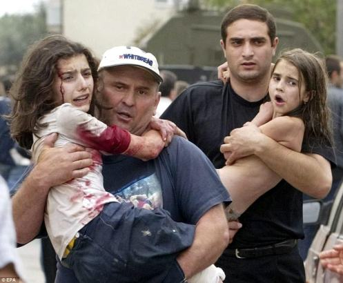 018210DD0000044D-4375518-Over_330_people_half_of_them_children_were_killed_in_2004_when_p-a-142_1491232737512