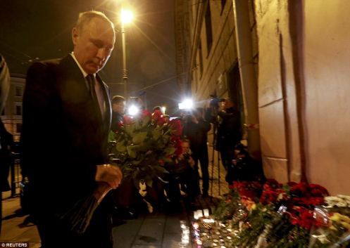 3EE908E400000578-4375518-Russian_President_Vladimir_Putin_has_laid_flowers_in_tribute_to_-a-12_1491251132978