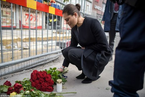 3F10CF1900000578-4392974-The_39_year_old_laid_flowers_following_the_terrorist_attack_in_t-a-15_1491650825506