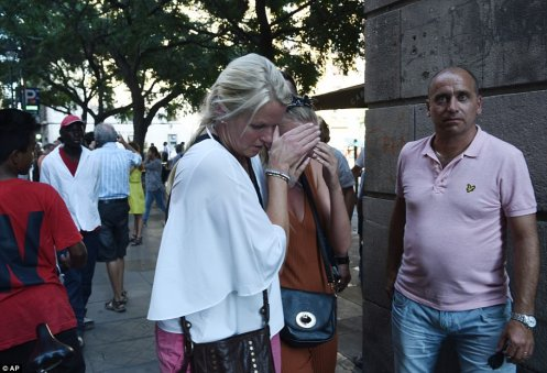43551BDB00000578-4799836-Pictured_A_woman_is_comforted_as_crowds_flee_from_the_scene-a-15_1502996439754