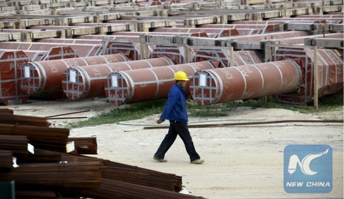 A Chinese worker walks at the construction site of the new Great Mosque, which is being built by the China State Construction Engineering Corporation, in Algiers, Algeria