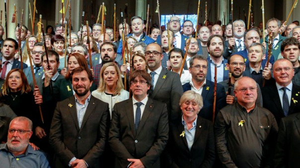 Former Catalan leader Carles Puigdemont and former cabinet members sing the Catalan anthem during a meeting with Catalan mayors in Brussels