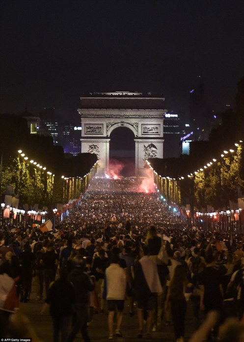 4E1A5CB600000578-5939247-Supports_lit_flares_as_they_made_their_way_down_the_Champs_Elyse-a-46_1531260806650