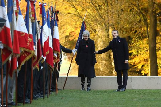 5986538-6374507-British_Prime_Minister_Theresa_May_and_France_s_Macron_are_seen_-a-19_1541853181677