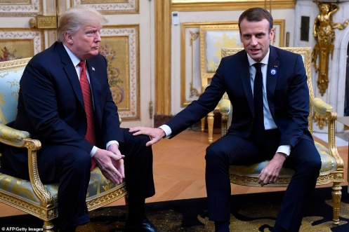 6015018-6374507-Donald_Trump_looks_on_at_French_president_Emmanuel_Macron_prior_-a-5_1541853181142