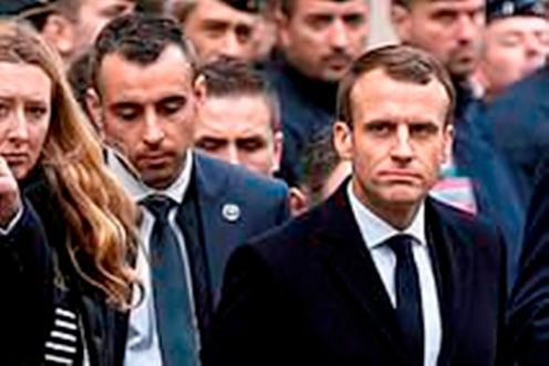 6906970-6451503-Macron_surveys_the_damage_in_Paris_today_with_a_burnt_motorbike_-a-55_1543779676618