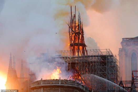 12308698-6925015-The_flames_have_engulfed_large_parts_of_the_Cathedral_located_in-a-224_1555356216929 (1)