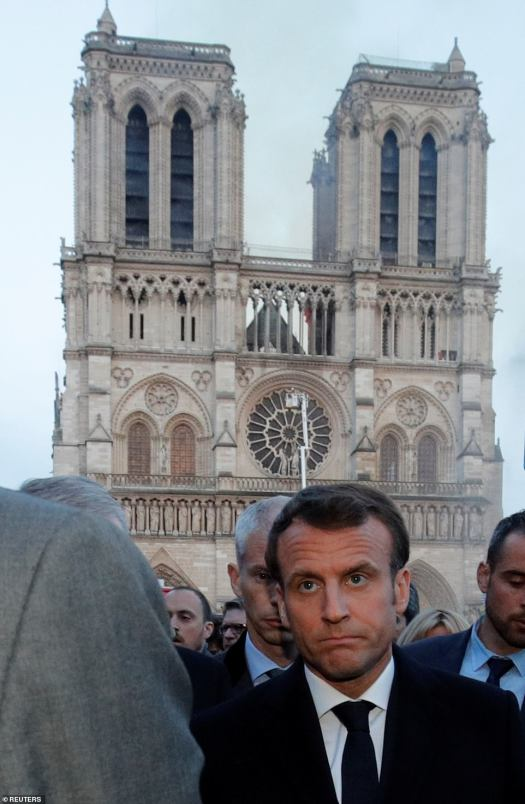 12311970-6925015-A_visibly_upset_Emmanual_Macron_walking_near_the_Notre_Dame_Cath-a-272_1555359075088