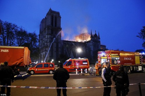 12314738-6925015-A_cordon_is_in_place_as_fire_crews_spray_water_on_the_gothic_cat-a-381_1555363818337