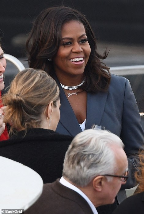 12355074-6928937-Mrs_Obama_was_pictured_smiling_and_sipping_wine_as_she_mingled_w-a-25_1555440231672