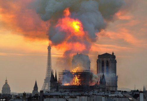 12358952-6929643-Pictured_the_blaze_at_Notre_Dame_yesterday_Much_of_the_roof_was_-a-91_1555453712206